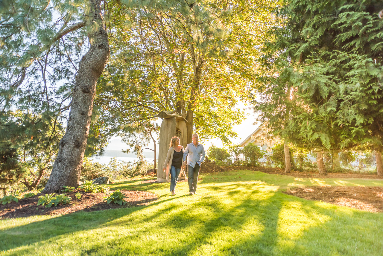 Couple walking in the sun under trees